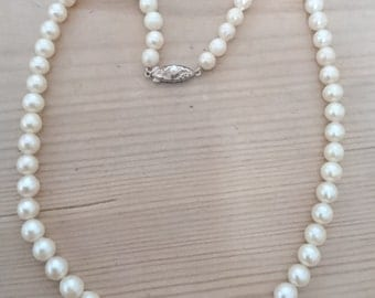 Beautiful real Pearl necklace with sterling silver clasp