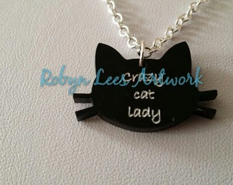 Crazy Cat Lady Laser Cut Necklace with White Writing on a Cat's Head Shape Charm on Silver Chain