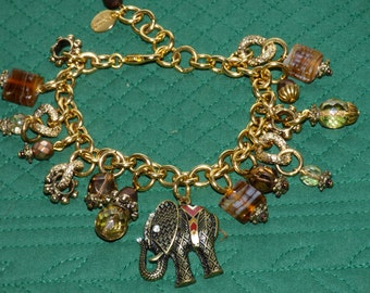 Anna Bijoux Elephant Charm Bracelet - 15 Charms - Faceted Charms - Metal Charms - Original Gold Metal Tag - Gift Worthy - Clean and Classy