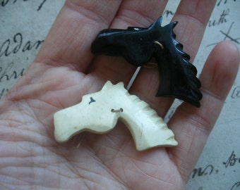 2 vintage horse head buttons, early plastic