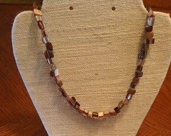 001 necklace shell coffee color