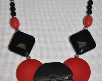 Red and black Art Deco Bakelite, vintage lucite, and black onyx one-of-a-kind statement necklace.