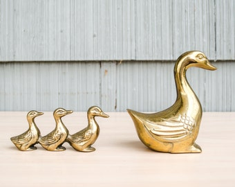 Adorable, vintage brass duck family