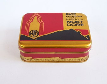 Tin box  of jelly made with mineral water from Mont Dore french medicine red and gold tin box  vintage  Made in France