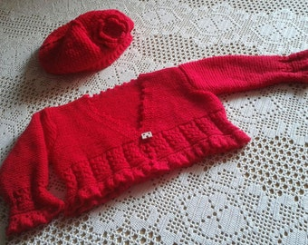 Handknitted baby cardigan and hood