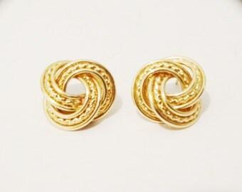Vintage 14kt Stamped 6 grams Swirl Earrings.