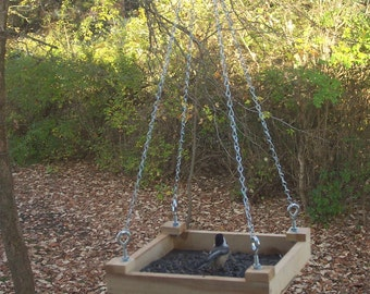 Open air hanging platform bird feeder.