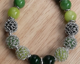 Handmade bracelet. Wire silver crochet, green jasper beads and 950 silver clover pendant