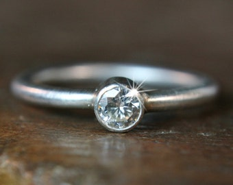 Handmade recycled silver & lab grown solitaire moissanite engagement ring.