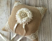 rustic burlap ring bearer pillow with lace handmade flower and rhinestone pearl metal button.