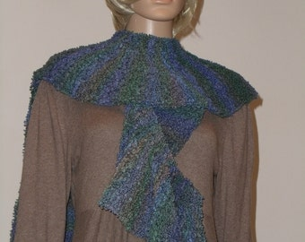Long knitted scarf from a Boucle yarn with a gradient from green and blue and violet tones