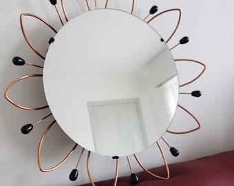 Sunburst mirror, but with flower leafs. Solar mirror but then as flower