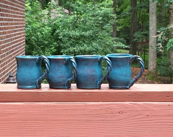 Set of 4 opalescent blue mugs