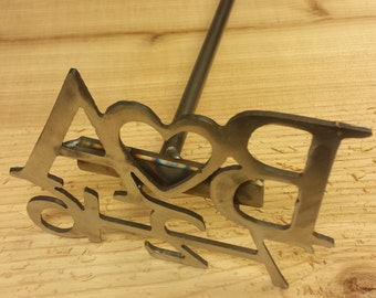 nice heavy duty metal letter branding iron with slab of wood wedding unity