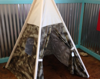 """Camouflage and natural canvas teepee with window, wood poles included, comes assembled and ready to play, approximately 48"""" wide by 64"""" tall"""
