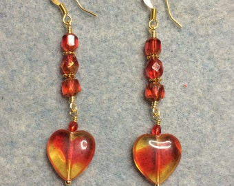 Red and yellow Czech glass heart bead dangle earrings adorned with bright red Czech glass beads.