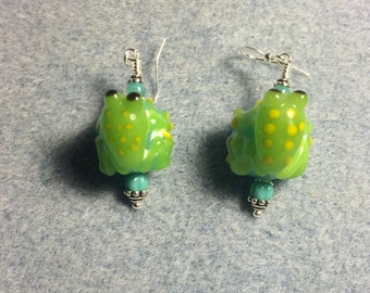 Turquoise and green lampwork frog bead dangle earrings adorned with turquoise Czech glass beads.