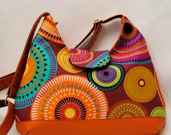 Handmade faux leather phoebe bag decorated with aurora borealis designer fabric