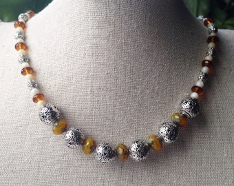 "Beaded necklace, burnt orange, cream, ochre, and silver, 17"" - 18"""