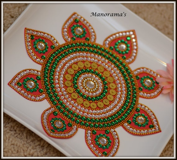 Floor art green and whie kundan rangoliwedding center for Floor rangoli design