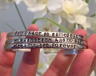 Laughter is timeless-hand stamped cuffs-set of three