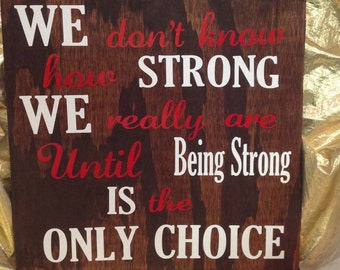 "Inspirational sign ""we don't know how strong we really are until being strong is the only choice"""
