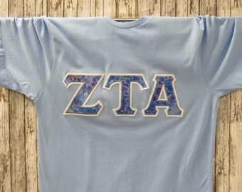 light blue short sleeve sorority double stitched letters shirt