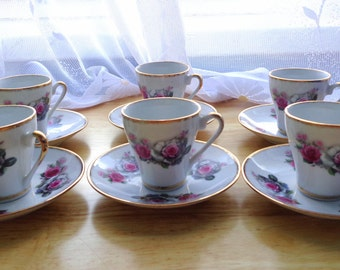 6 painted cups and saucers