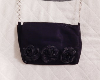 Black purse with 3D flowers