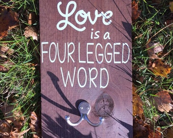 Love is a Four Legged Word Wooden Sign with Hanger