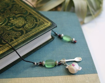 Bookmark with silver spoon and sugar pot