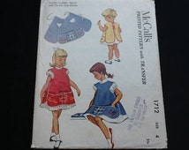 McCall's pattern 1712. Vintage 1952 girl child cobbler back tied apron with tic tic toe game. Sizes 2, 4, 8.