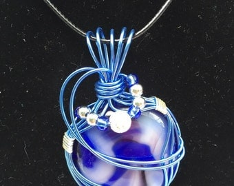 Blue, teal, and purple wire wrapped, fused glass pendant