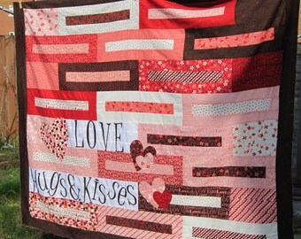 Hand made 'Love, hugs and Kisses' quilt/blanket.