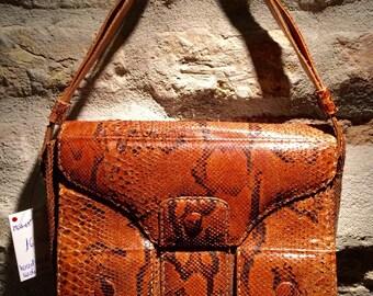 1960's handmade snakeskin shoulder bag with adjustable strap.