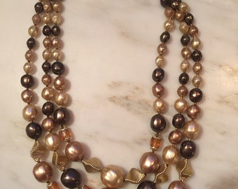 Vintage Japan gold tone three atrand beaded necklace