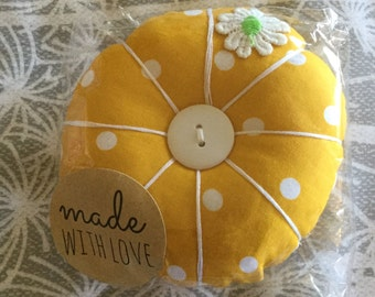 Pin cushion in Sunny Yellow polka dot fabric with daisy appliqué and buttons. A fabulous accessory for your sewing box