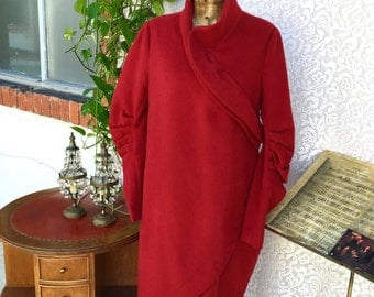 Deep red coat. Amazing shape! Something different from usual and boring...