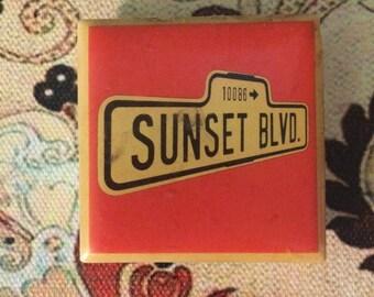 Vintage Ceramic Tile Broadway Musical Magnet: Sunset Blvd. Orange