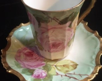 Limoges Flambeau Handpainted demitasse cup and saucer