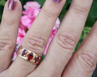 Etched rose gold cigar band ring with garnets.