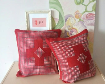 Pillowcase have beautiful red colour with crosses which have another colours