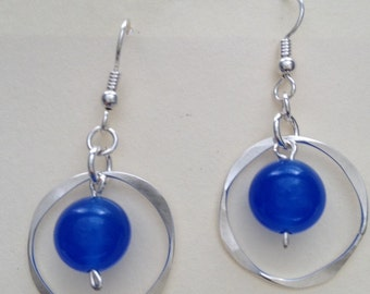 Silver foraged circle dangle earring with bead.