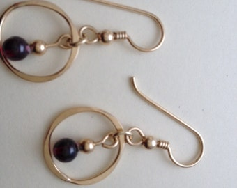 Dainty goldfilled circle earrings  with garnet bead.