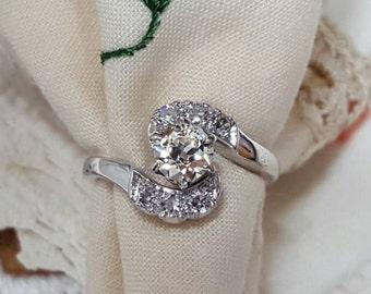 Vintage platinum ring with old European round cut diamond.