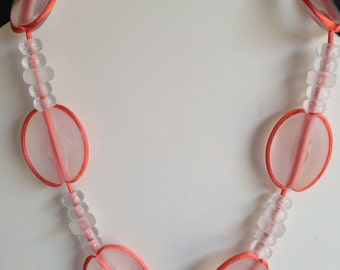 White and orange whimsical necklace
