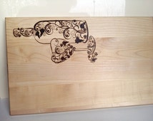 "Wooden cutting board with handmade ""bottle of vine and glass abstract"" pyrography design."