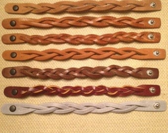 "Leather braided bracelets. These unique ""magic braid"" bracelets are handmade in my shop. They make great gifts for any occasion."