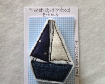 Free stitch sailboat brooch