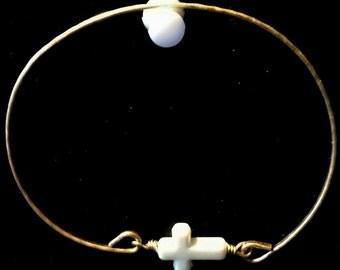 Thin white cross bangle